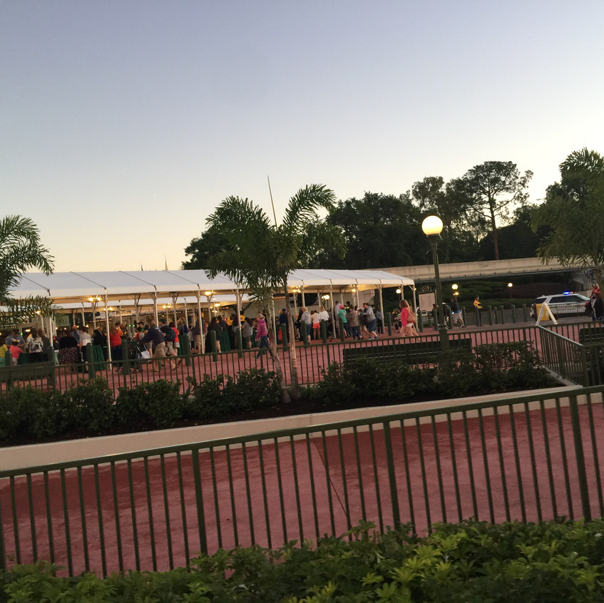 The Disney Resort Buses empty out and all funnel to a large security check point