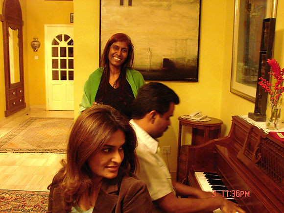 Mohammed Haddad playing piano with his mother and sister