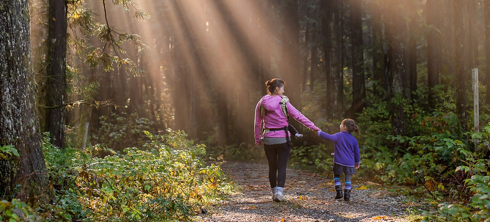 Sun%20rays%20beating%20down%20on%20mother%20and%20daughter%20walking%20in%20forest_edited.jpg