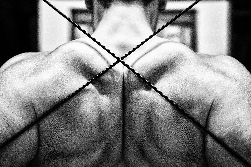 A males back showing muscular definition