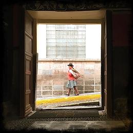 a-woman-walking-framed-in-a-hotel-doorway-in-cusco-peru-(credit-F1FTY).JPG