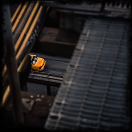 a-yellow-cab-passes-over-the-brooklyn-br