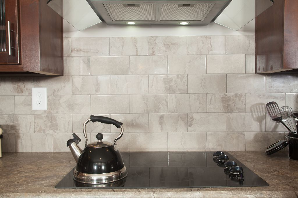 Cooktop stove w/ ceramic backsplash