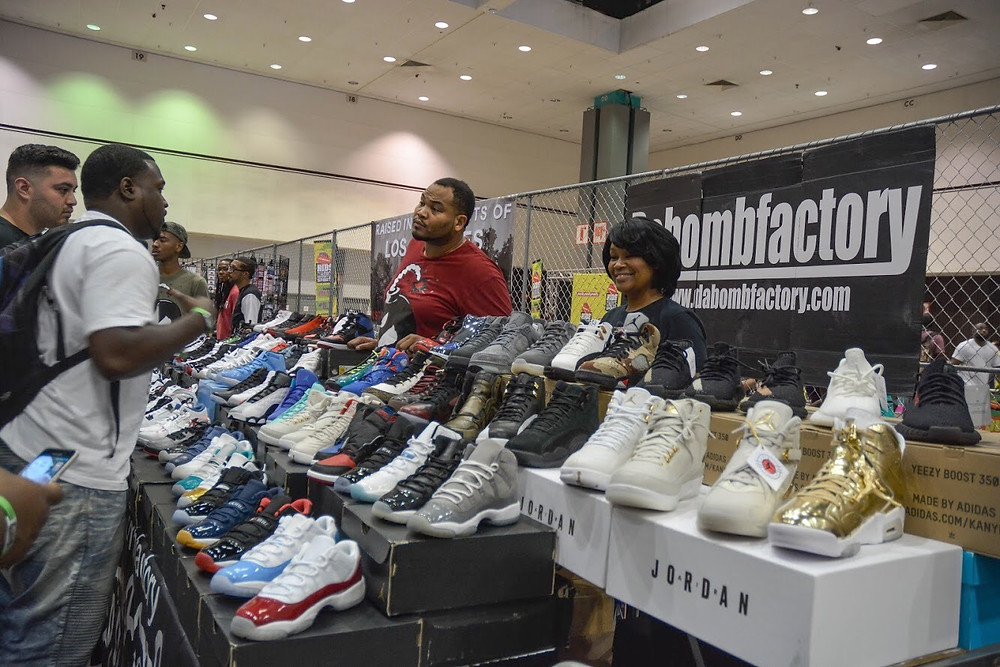 Vendors set up pop-up shops inside the Los Angeles Convention Center during the BET Fan Fest's Kicksperience. Seen in the photo are owners of Dabombfactory shoe company.