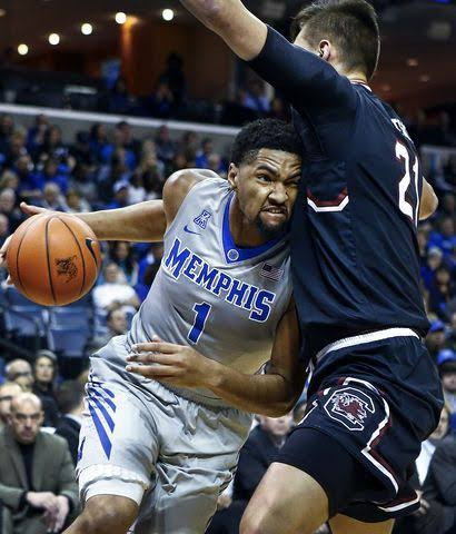 Dedric Lawson drives to the basket during a game against South Carolina on Dec. 30, 2016. (Photo by Jaleesa Collins/T.G. Sports)