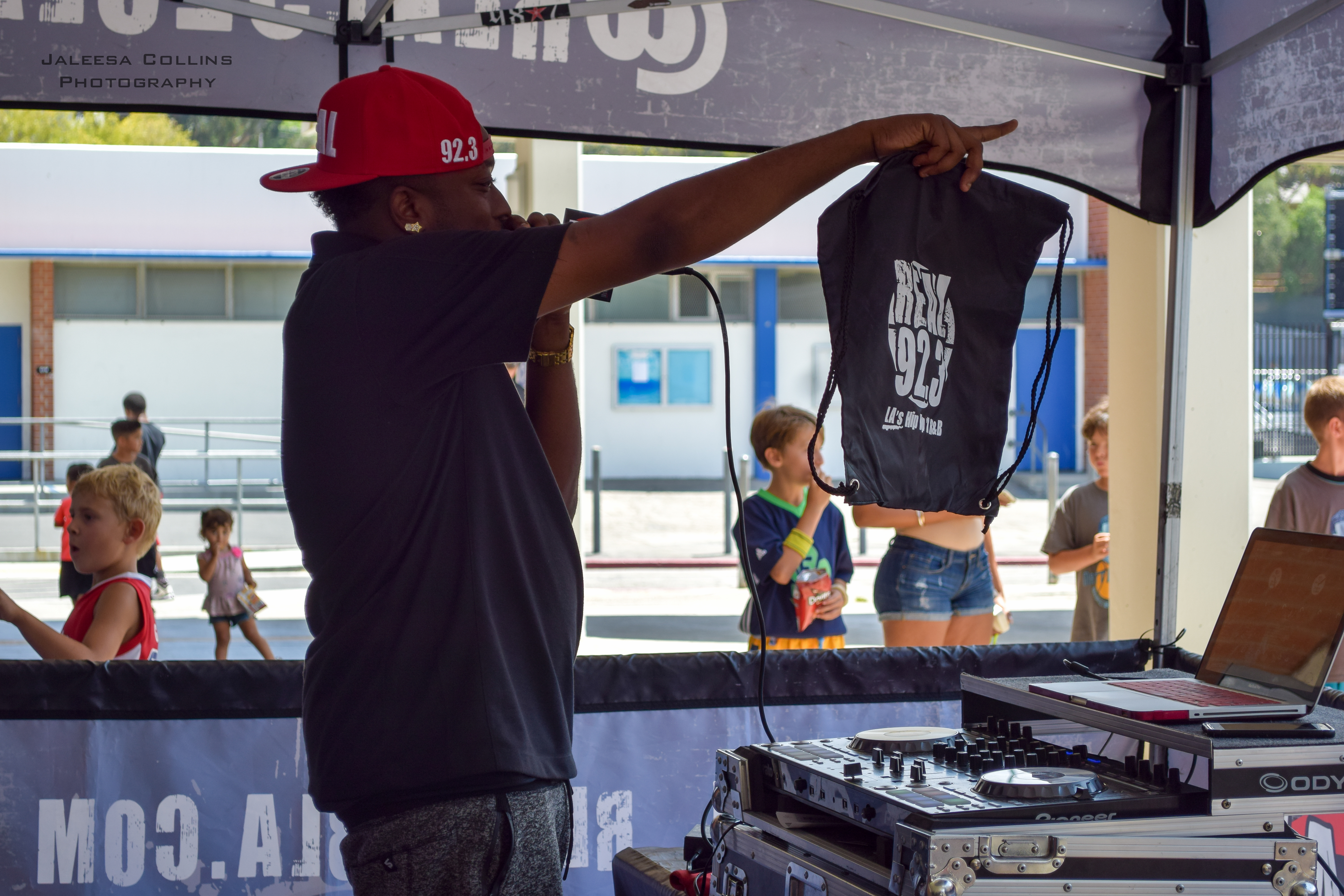 A DJ from REAL 92.3 LA hosting.
