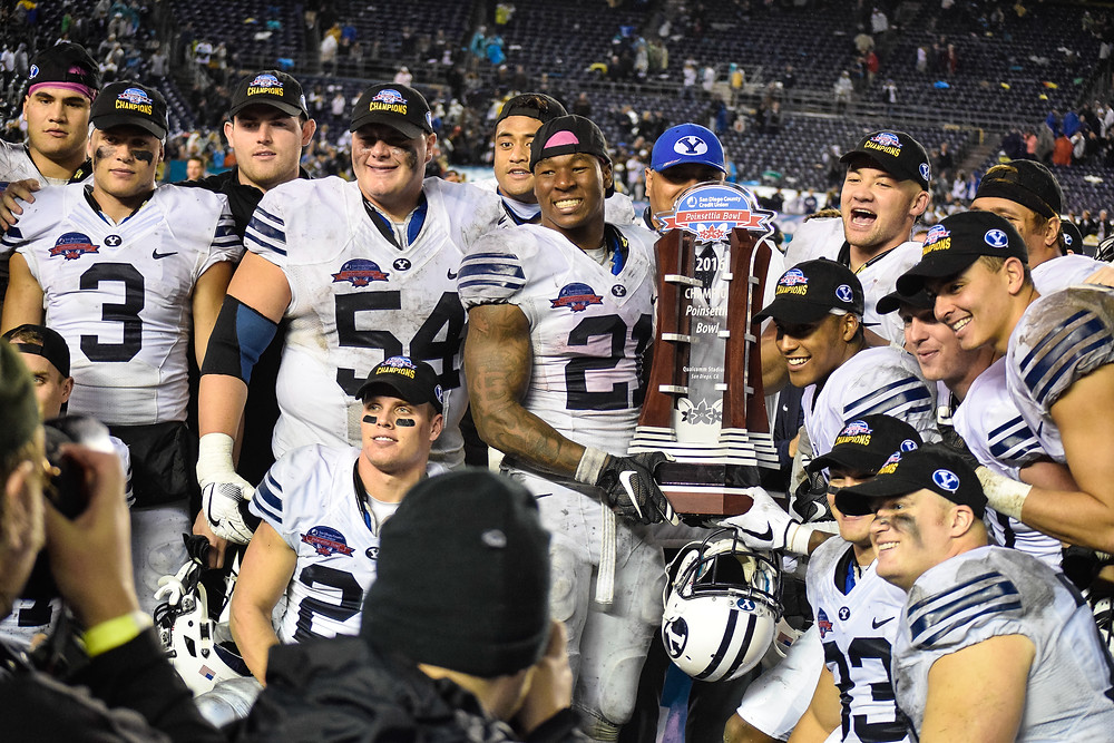 BYU celebrates their 24-21 victory over Wyoming.