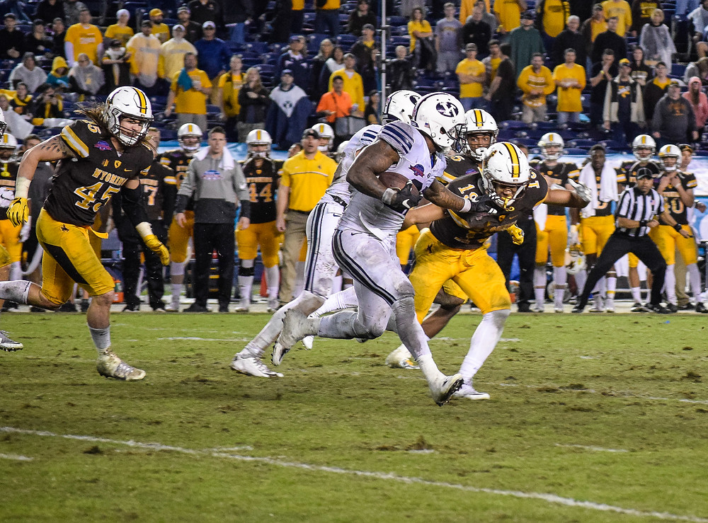 BYU's Jamaal Williams rushing the ball for yardage on a run play.