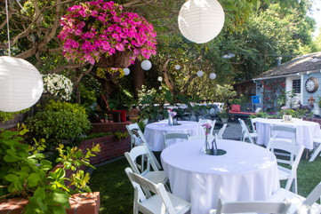 Our tables and chairs set up for this beautiful garden reception.