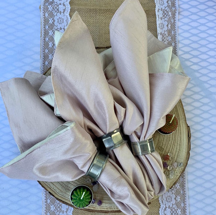 Delicate linens with our assorted antique napkin rings.