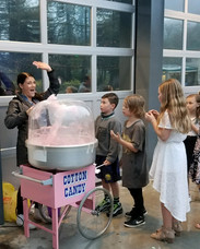 Serving up cotton candy at a local school dance.
