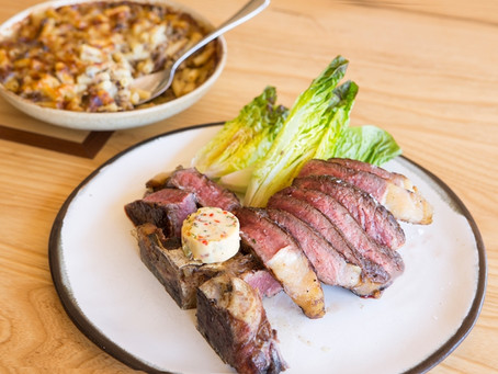 Barbecue T-bone steak with devilled butter and oxtail macaroni cheese