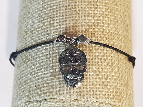Bracelet élastique argenté/noir/tête de mort