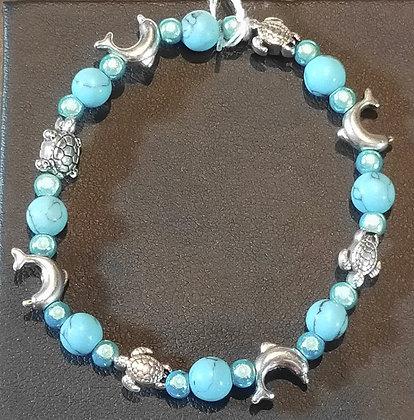 Bracelet enfant turquoise, dauphins, tortues