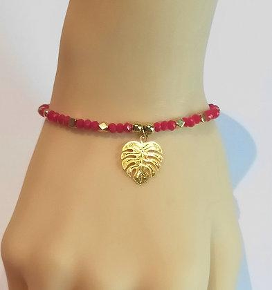 Bracelet doré/rouge perles à facettes, feuille de palmier