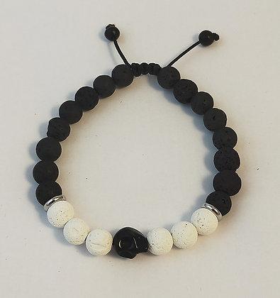 Bracelet ajustable pierre de lave noir&blanc, tête de mort howlite noire
