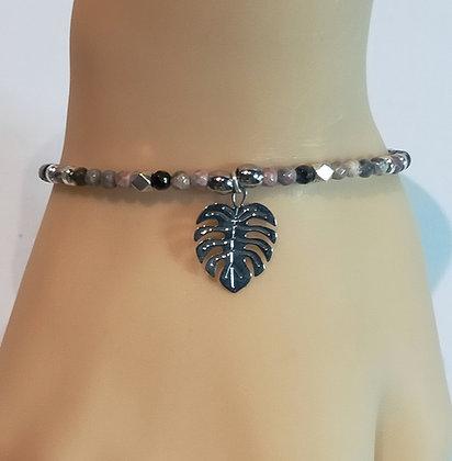 Bracelet rose/noir à facettes feuille de palmier