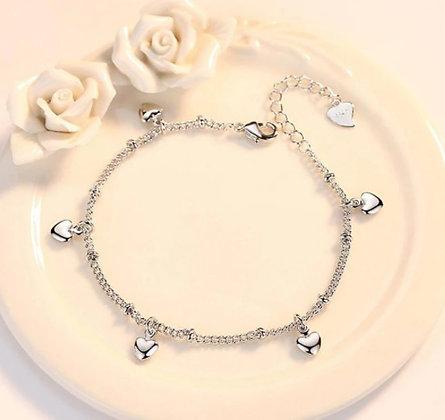 Bracelet en argent 5 cœurs