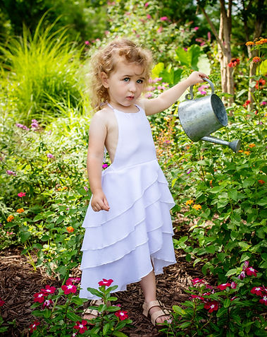 girl with water can in butterfly garden