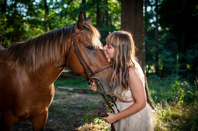 girl kissing horse 1 7 19 a web carolina
