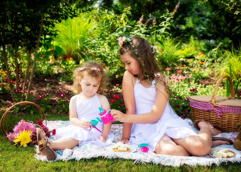 girls tea party in butterfly garden caro