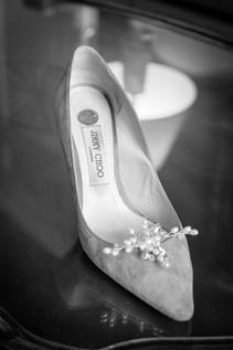 Brides shoe with sixpence at the duke mansion 1 carolina rose photography llc 2021