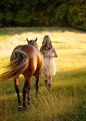 girl walking with horse 7 19 a web carol