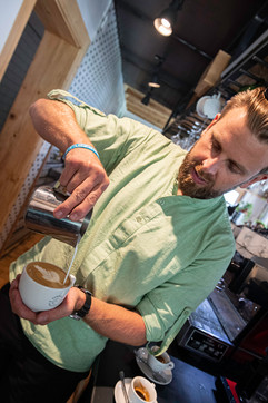 "Brewista Marian Podola in his mountain restaurant ""Aroleid Kollektiv""."
