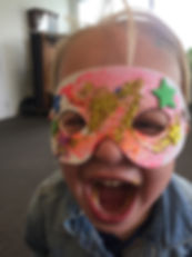 happy kid wearing mask arts and crafts