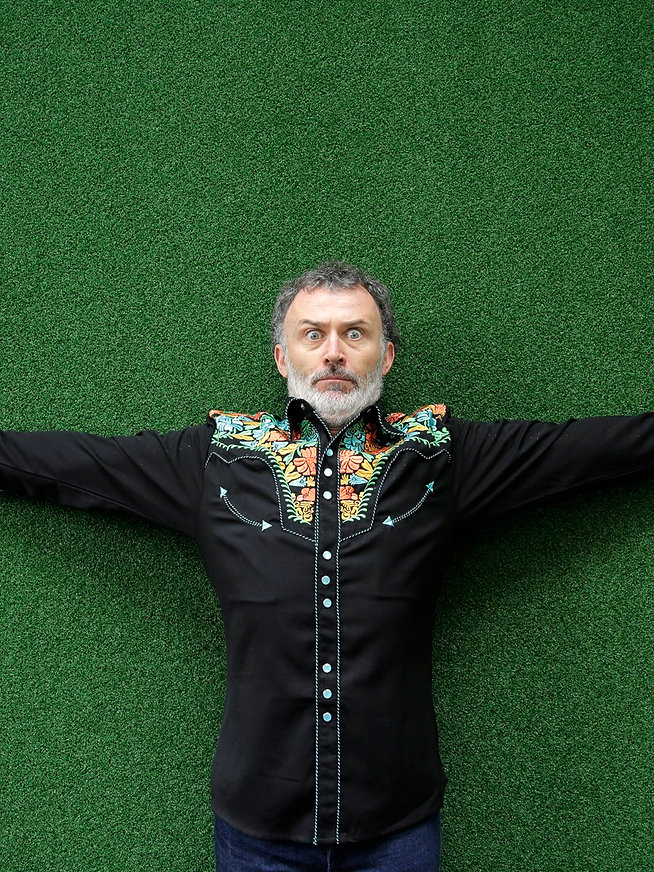Tommy Tiernan sitting down