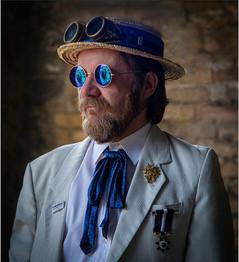 Man in Blue Glasses