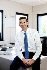 Kevin at desk.jpg