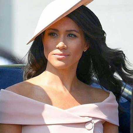 Why does Meghan Markle always wear neutral colours around the Queen?