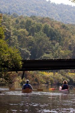 Kayaking up river.