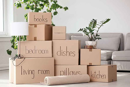 bigstock-Pile-Of-Moving-Boxes-And-House-