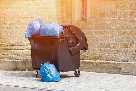 bigstock-Black-Plastic-Dumpster-With-Fu-