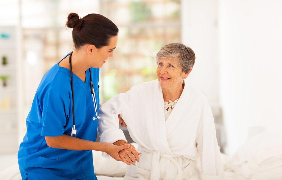female-nurse-helping-an-elderly-woman-wa