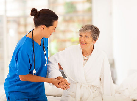 female-nurse-helping-an-elderly-woman-wa