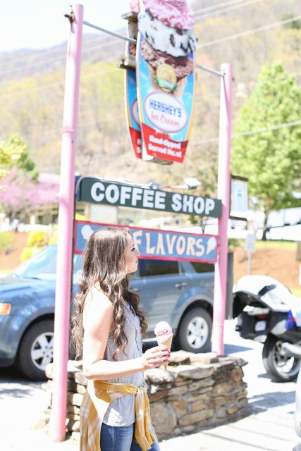 girl with ice cream in front of sign.jpg