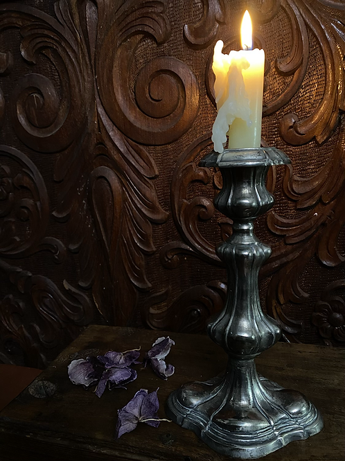 Weighted silver candle holder