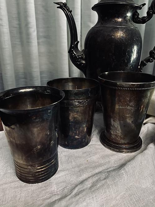 Three silver tumblers