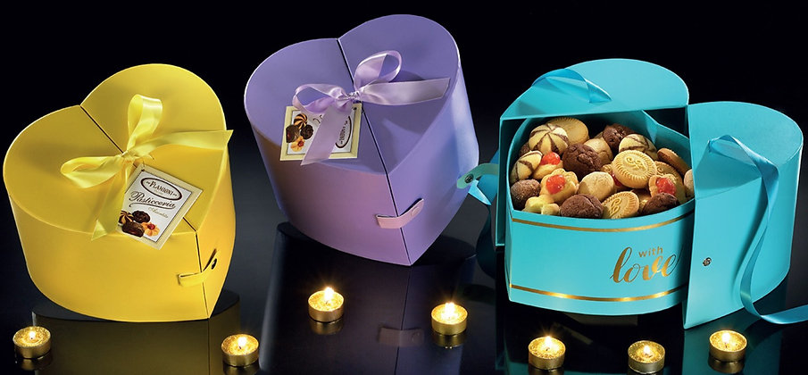 "The "" Heart  "" shaped cases with satin ribbon filled with Tea Biscuits"
