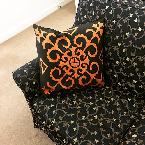 Grey and orange embroidered cushion cover