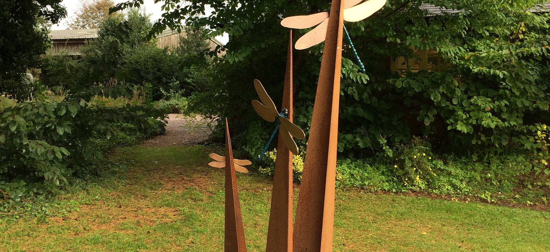 """Dragonflies on Blades"""