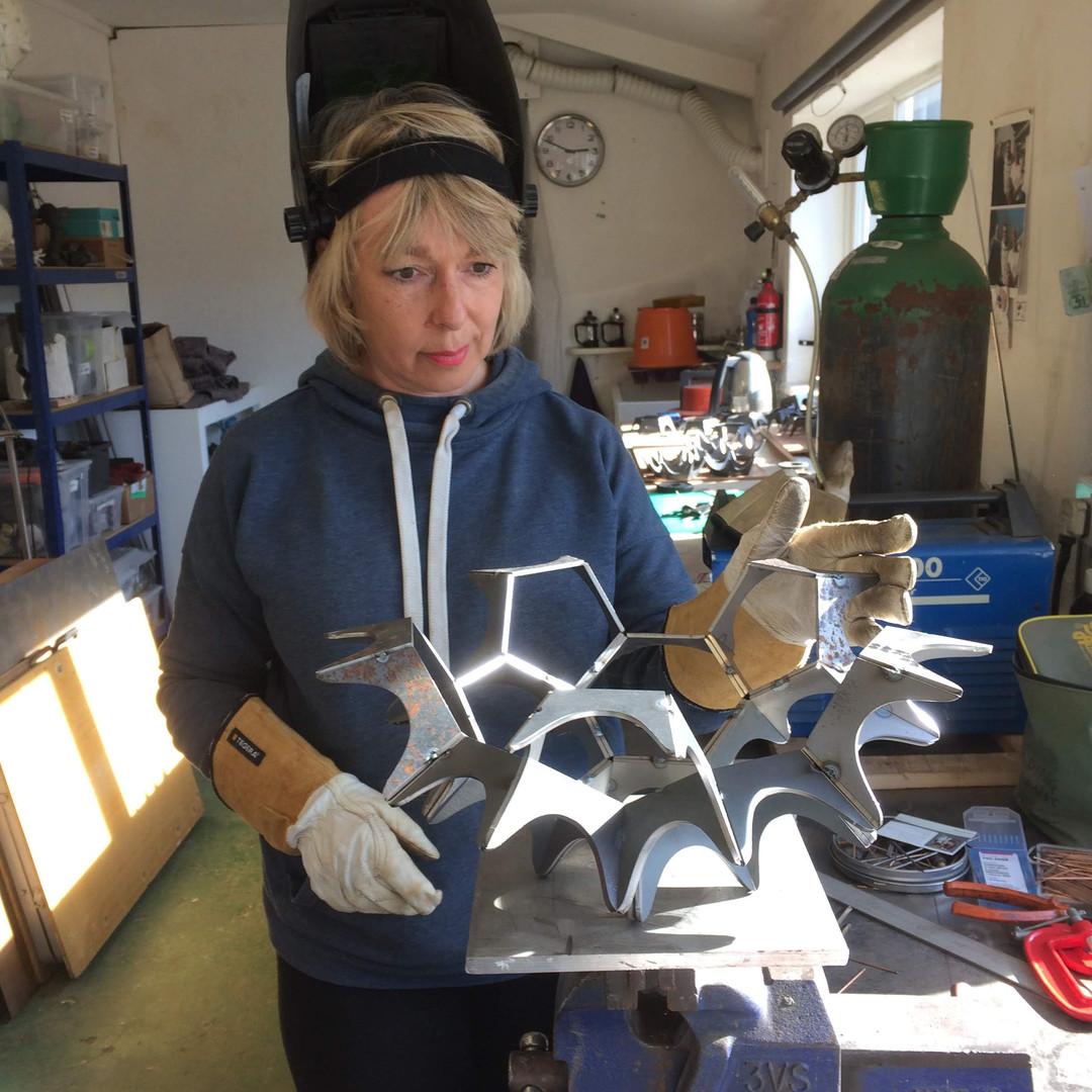 Joanne Risley in her studio making Virus
