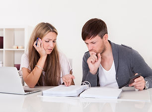 Unhappy young couple in financial troubl