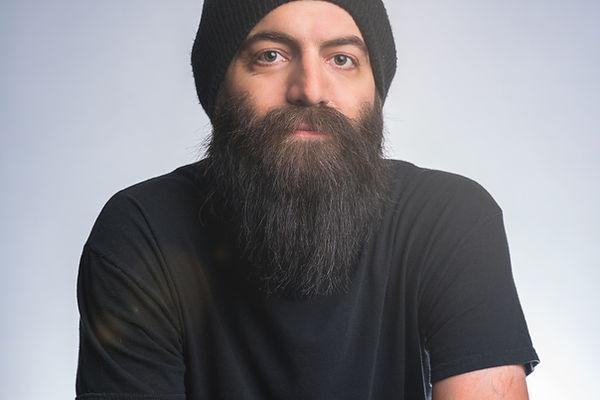 Portrait of Photographer, Steve Hubbard. He has a full and long brown beard.