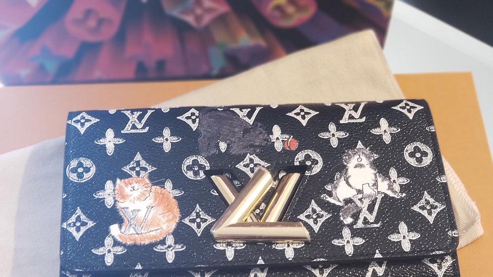 LOUIS VUITTON Monogram Grace Coddington Catogram Twist Chain Wallet