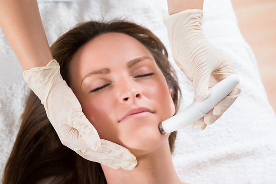 Young Woman Receiving Microdermabrasion