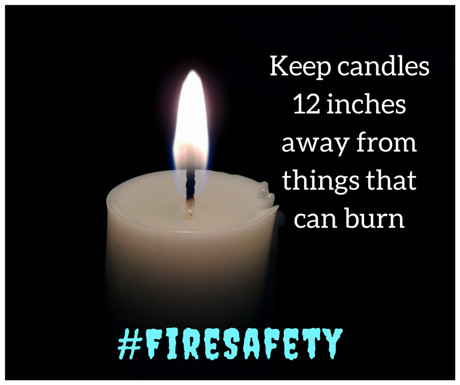 keep open flames at least 12 inches away from things that burn. picture of a candle #firesafety